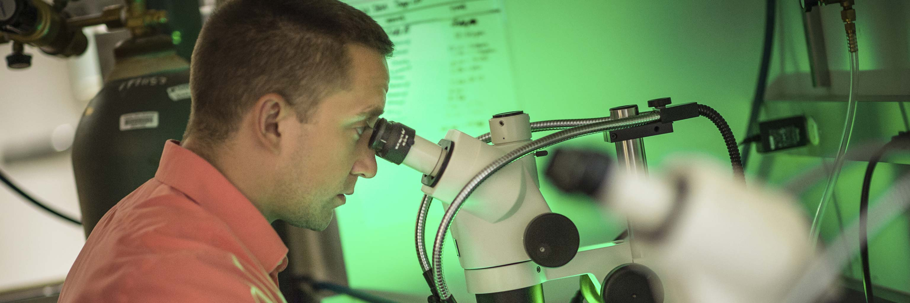 man looking into a microscope