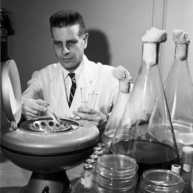 Professor Eugene Weinberg directing research on chelation (metal grabbing) by antibiotics in 1959.