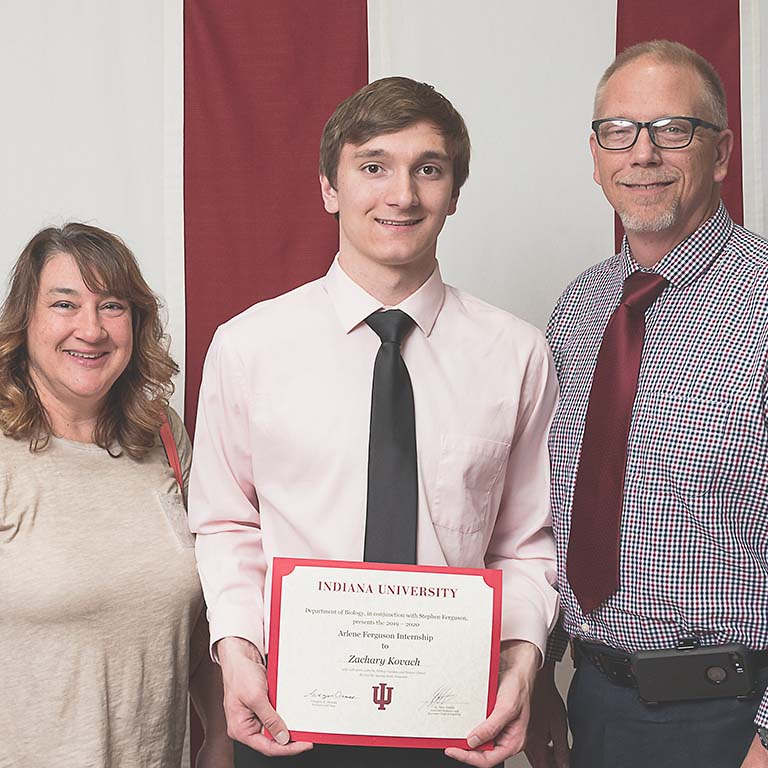 Zachary Kovach (center) poses for a picture with his parents, Deborah Kisters-Kovach and John Kovach, at the Student Awards Ceremony in May.
