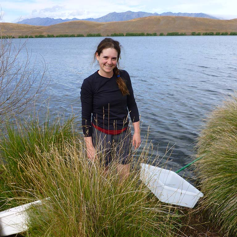 Mandy Gibson collecting snails at Lake Alexandrina in New Zealand.