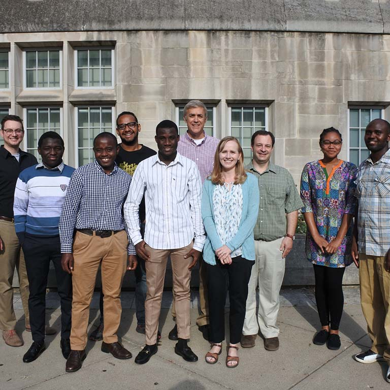 Posing for a group photo in front of Simon Hall are participants and hosts of IU Biology's first summer research program for African students to conduct research at IU to improve competitiveness of their applications to graduate school.