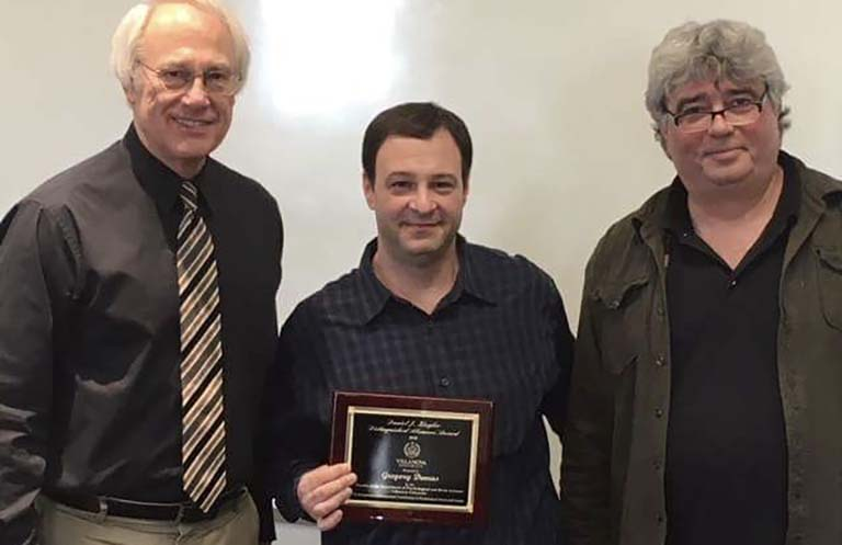 Villanova Professors Thomas Toppino (left) and Michael Brown (right) present Ziegler award to IU Professor Greg Demas (center) on March 23, 2018.