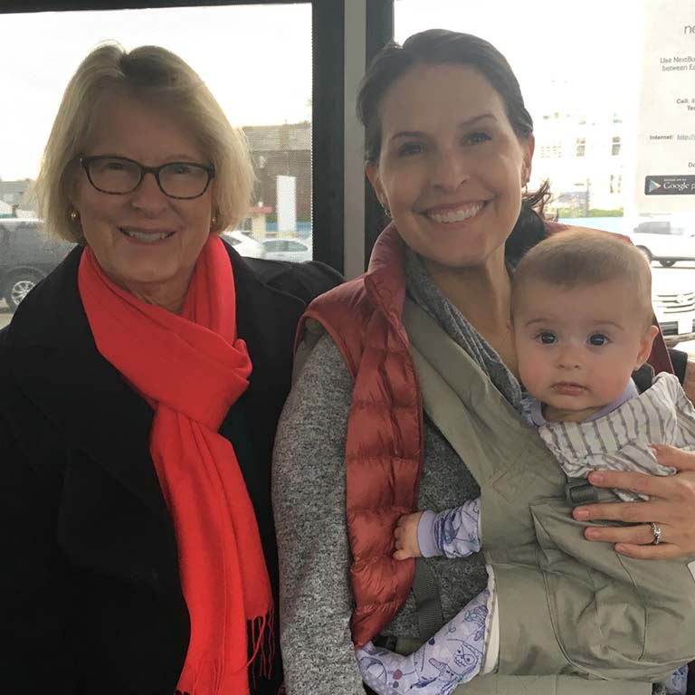 Rosvall's mother, Kim Rosvall, and Rosvall's baby daughter on their way to a conference. Rosvall's parents accompanied her to help care for the baby.