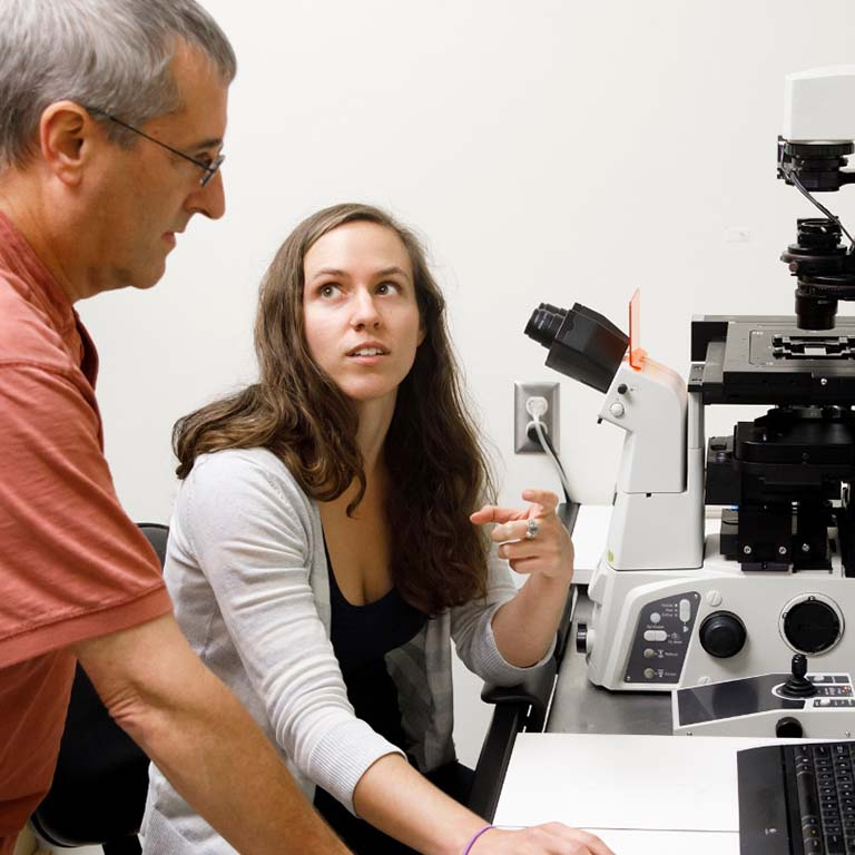 Courtney Ellison in the lab with her mentor Yves Brun.