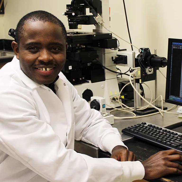 Gabriel Muhire Gihana at a computer in the lab.