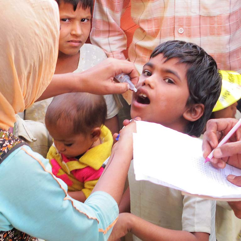 The oral polio vaccine being given to a boy.