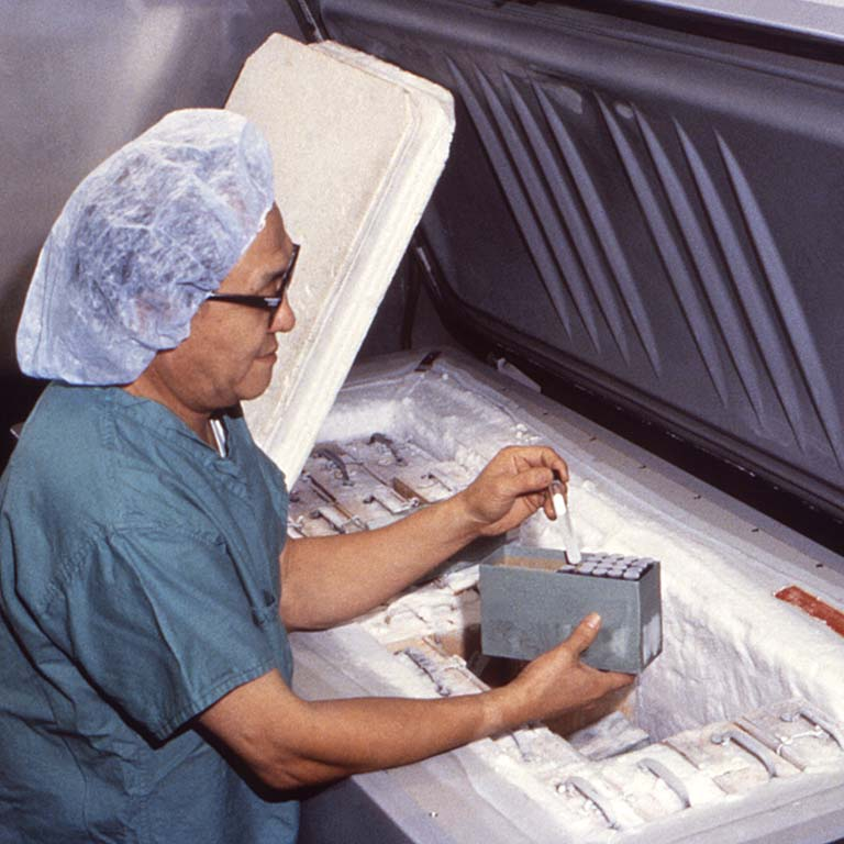 A lab worker pulls a vial containing smallpox virus from a freezer at a highly secured lab at the CDC in 1980.