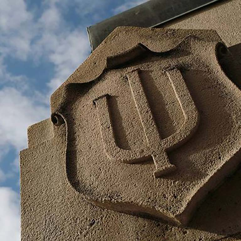 IU trident engraved in limestone.
