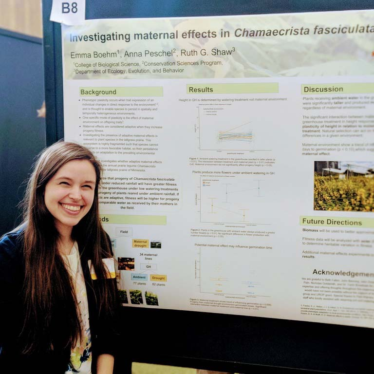 Emma Boehm presenting a poster at a conference.
