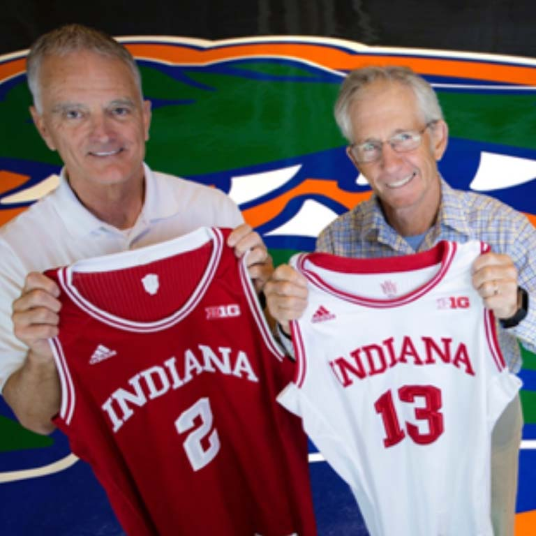 Rob Ferl (left) and Doug Soltis proudly hold up Hoosier basketball jerseys at the Stephen O'Connell Center—home of the Florida Gators—on the campus of the University of Florida, where they both work.